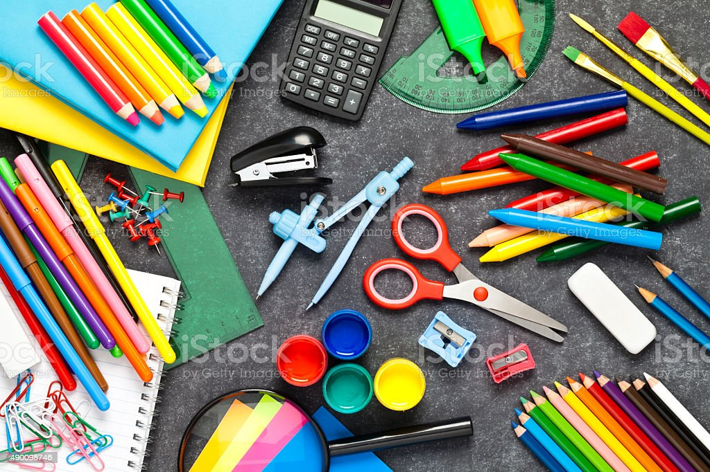 School supplies on black chalkboard background stock photo