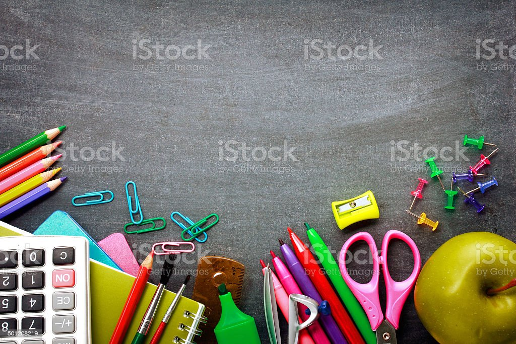 School supplies on blackboard background stock photo