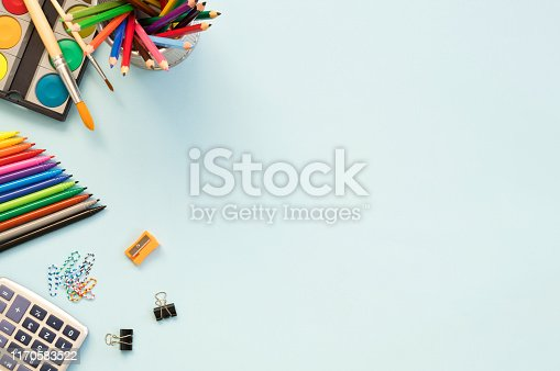 istock School supplies on blue background. Back to school concept 1170583522