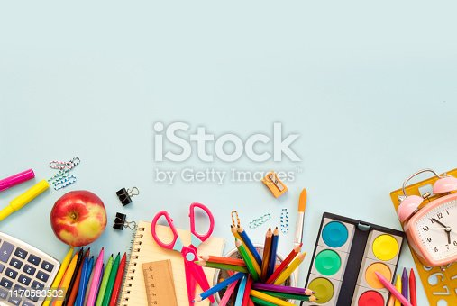 istock School supplies on blue background. Back to school concept 1170583532