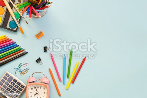 istock School supplies on blue background. Back to school concept 1170583544
