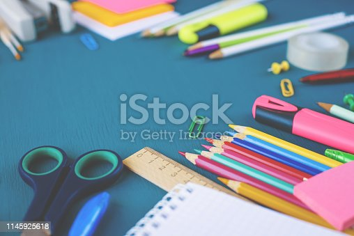 istock School supplies on blue background 1145925618