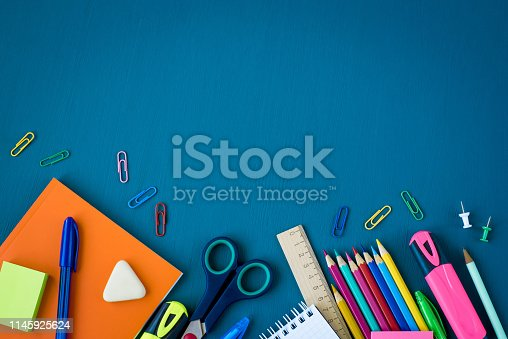 istock School supplies on blue background 1145925624
