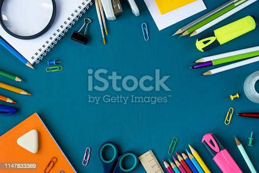 istock School supplies on blue background 1147833369