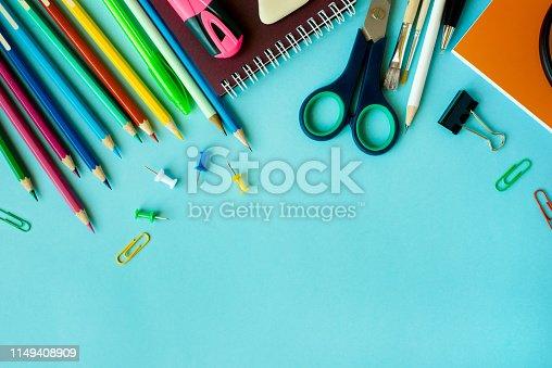 istock School supplies on blue background 1149408909
