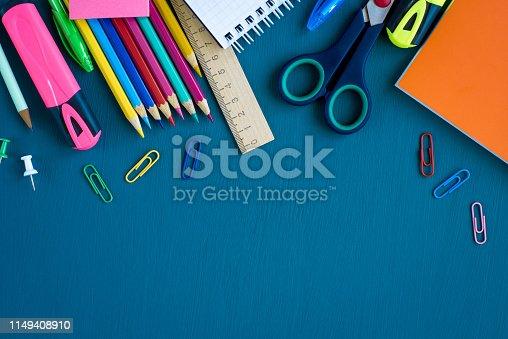 istock School supplies on blue background 1149408910