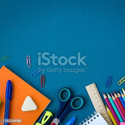 istock School supplies on blue background 1152249183