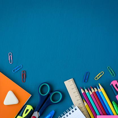 istock School supplies on blue background 1153471074