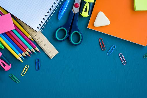 istock School supplies on blue background 1153471076