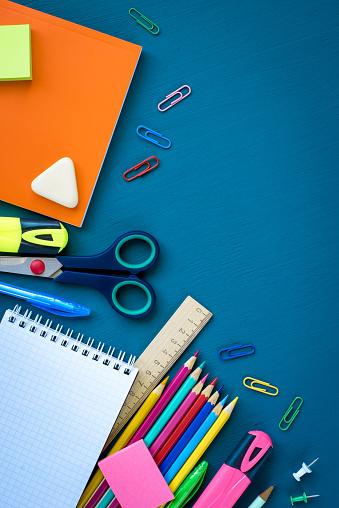istock School supplies on blue background 1156930980
