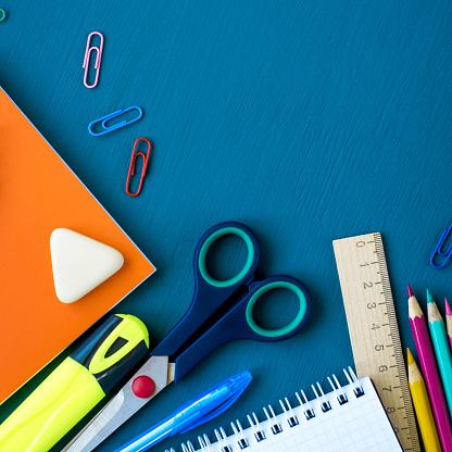 istock School supplies on blue background 1156931078