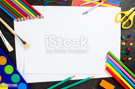istock School supplies on dark table 512527436