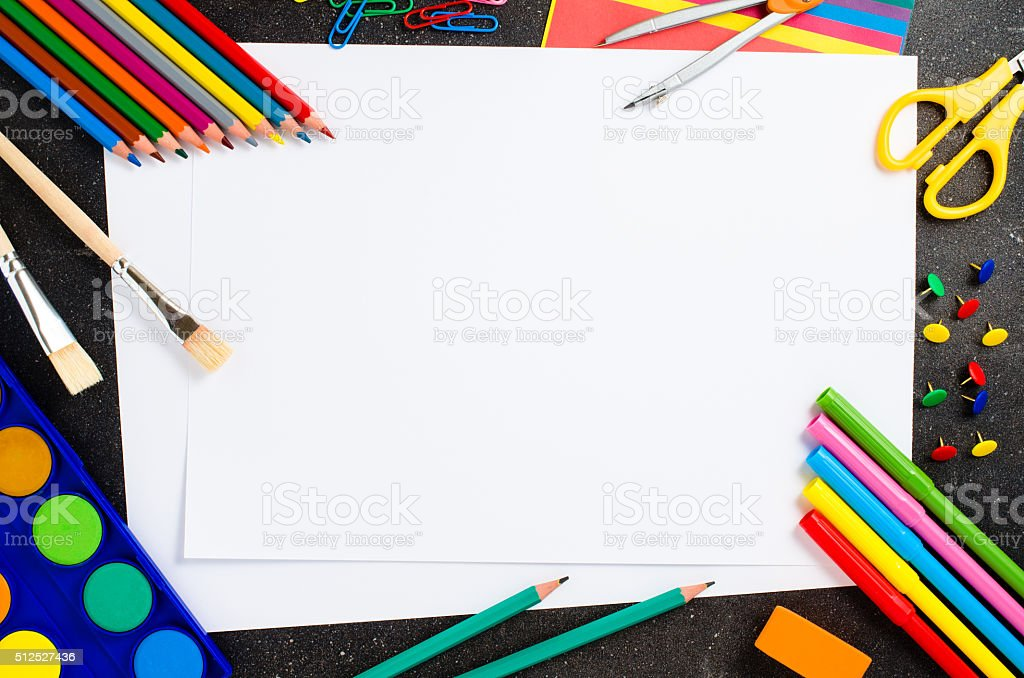 School supplies on dark table stock photo