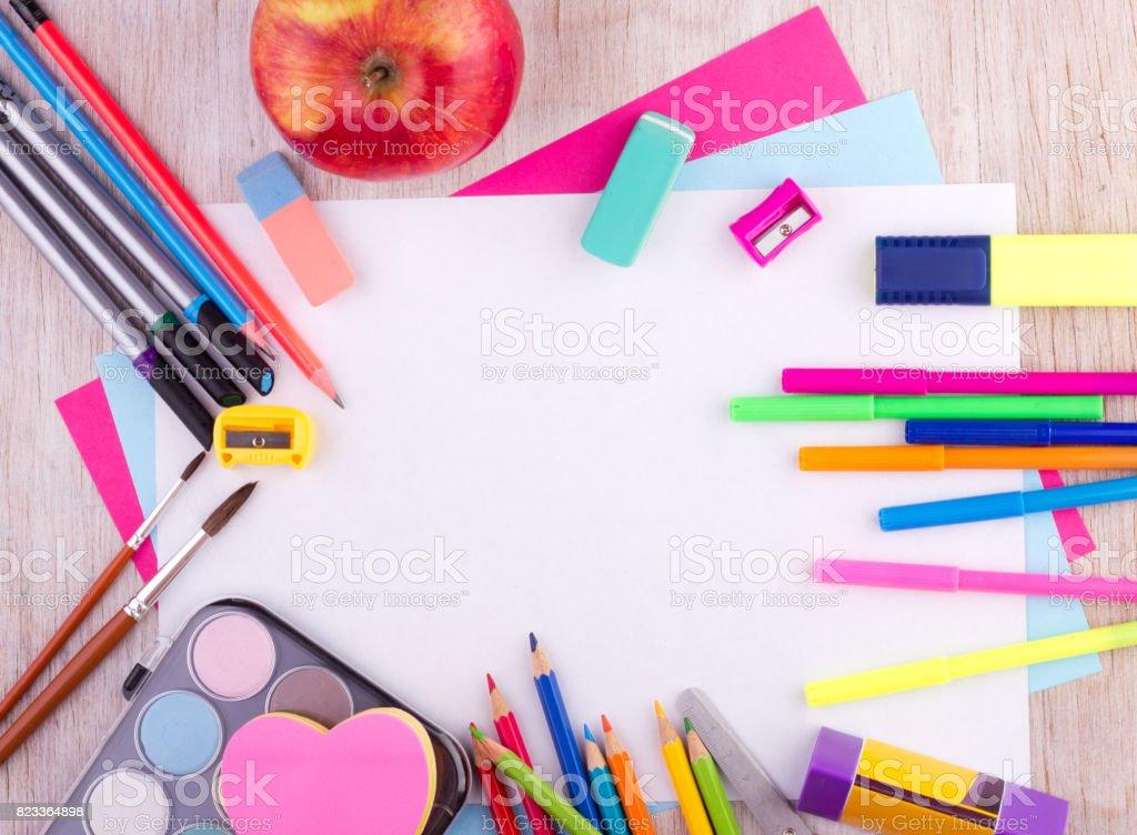 School supplies on desk stock photo
