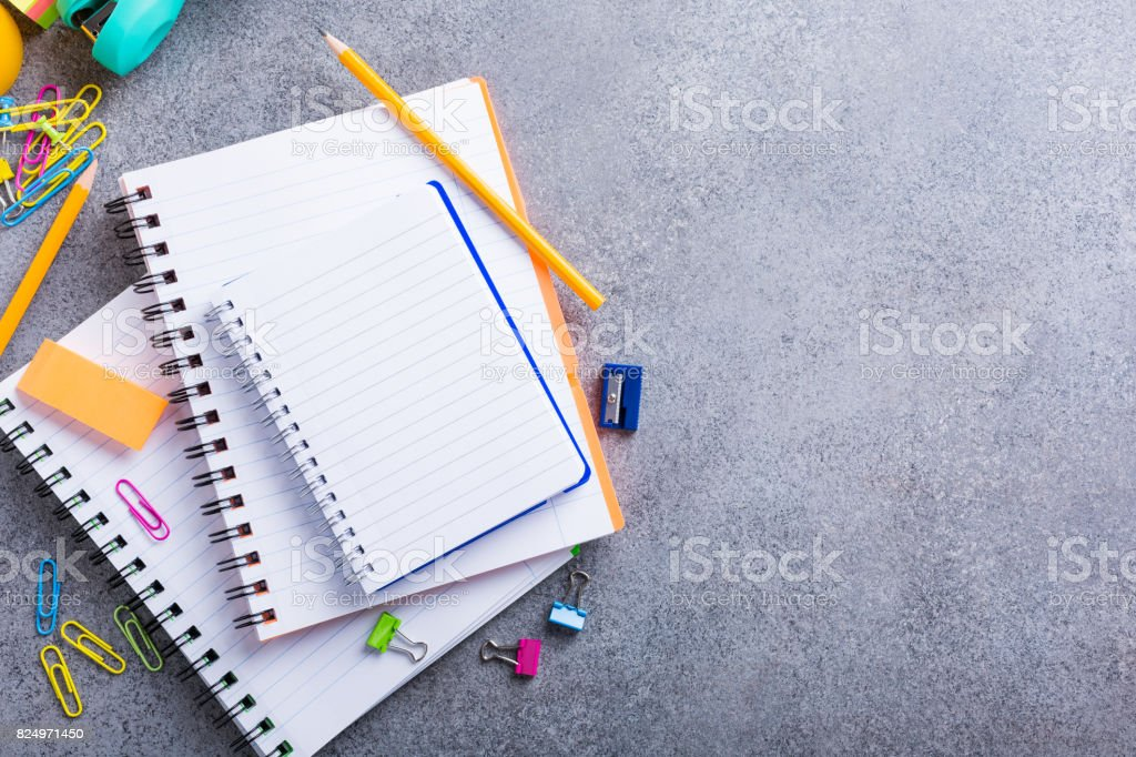 School supplies on gray stone background stock photo