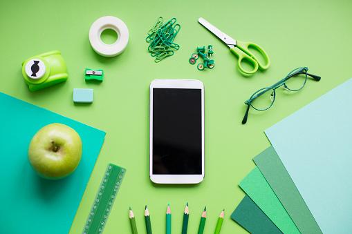 istock School supplies on green background 829436690