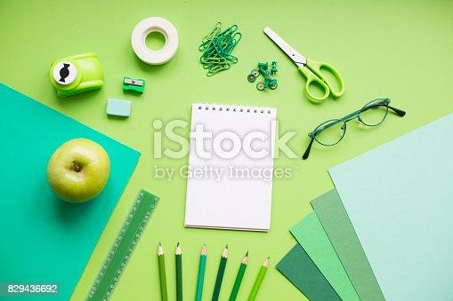 istock School supplies on green background 829436692
