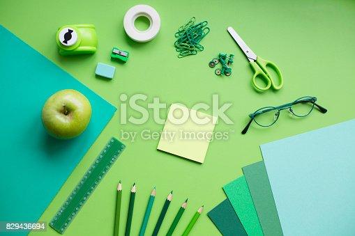 istock School supplies on green background 829436694