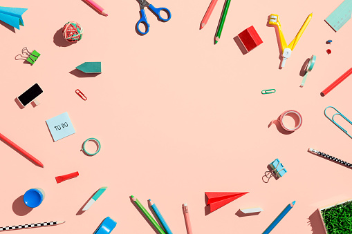 istock School supplies on pink table. Back to school concept. Flat lay image. 1148697739