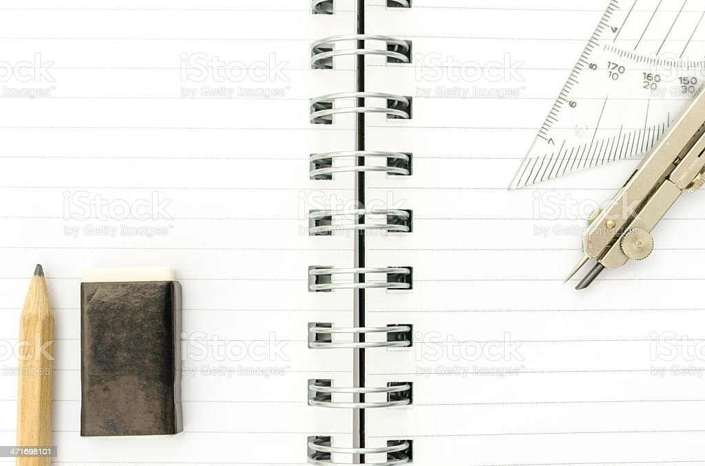 School supplies on spiral notebook royalty-free stock photo