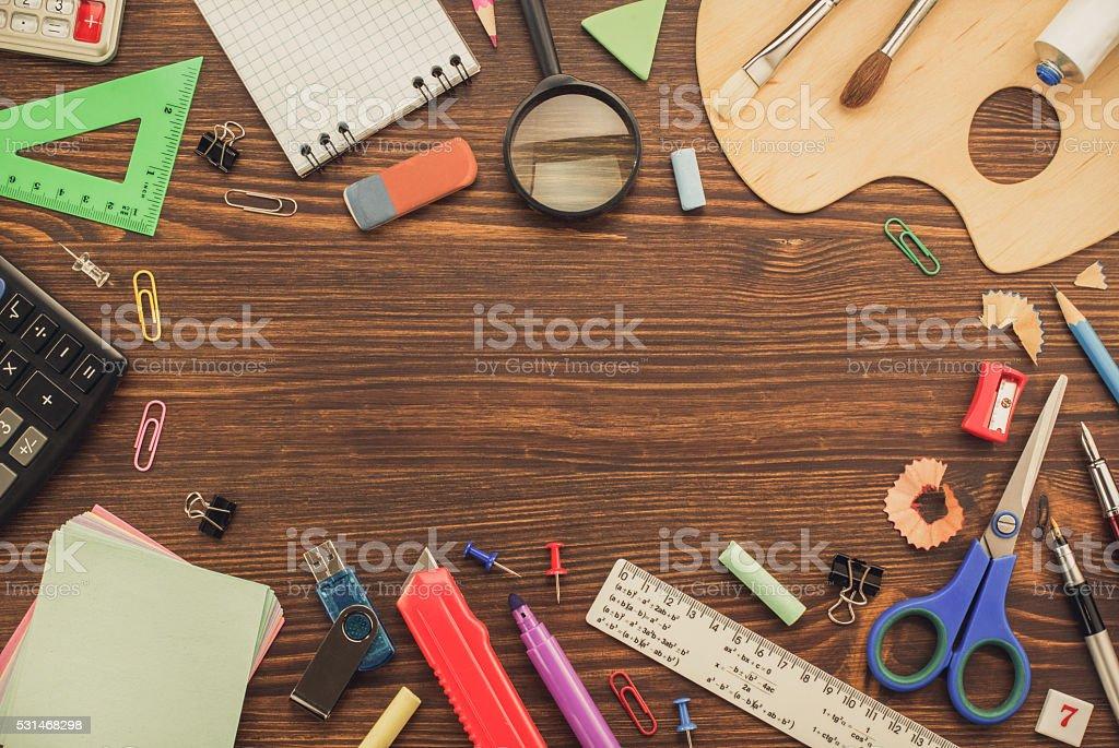 school supplies on wood stock photo