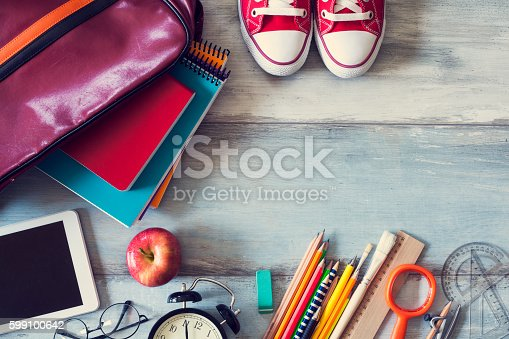 istock School supplies on wooden background 599100642