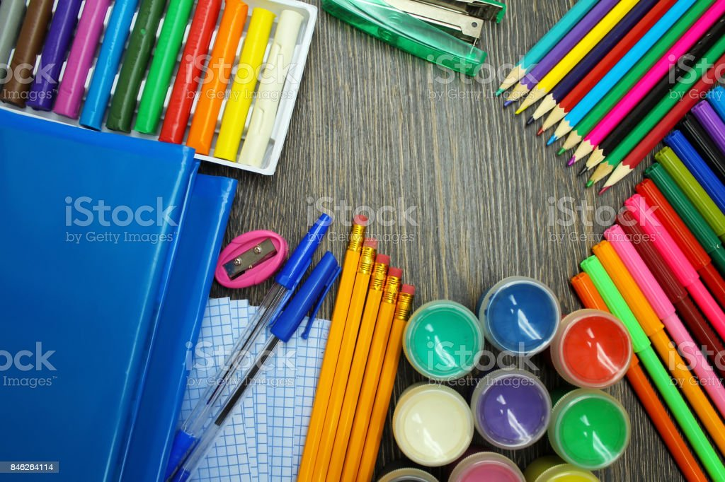 School supplies on wooden background. Schooling stock photo