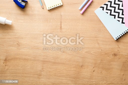 istock School supplies on wooden desk table background. Back to school concept. Flat lay, top view. 1159380456