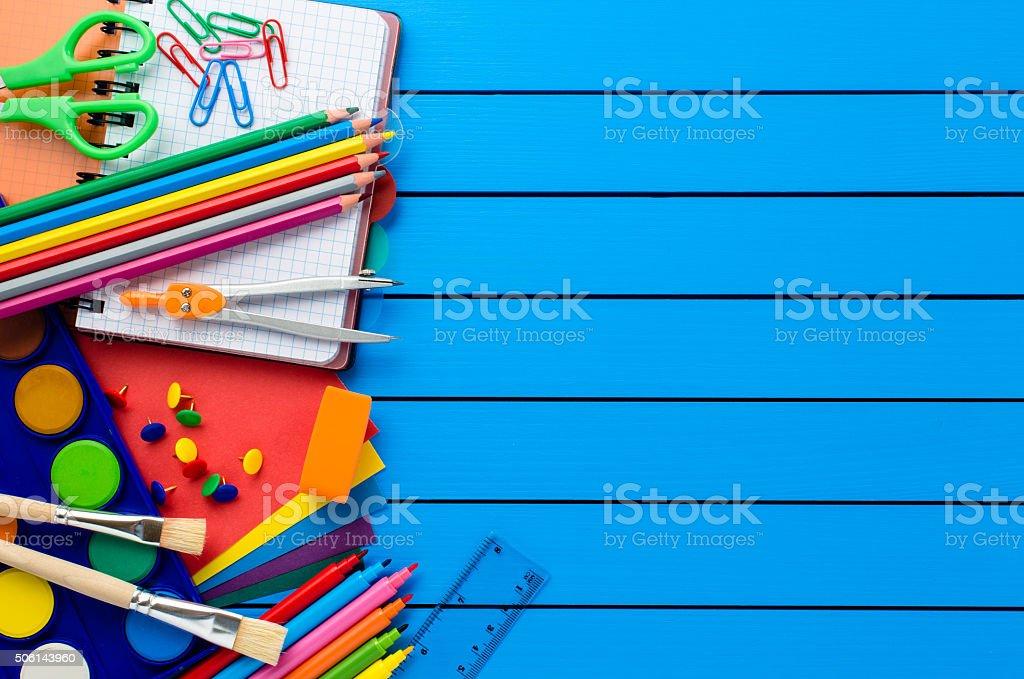 School supplies on wooden table stock photo