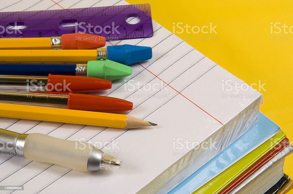 School Supplies on yellow background royalty-free stock photo