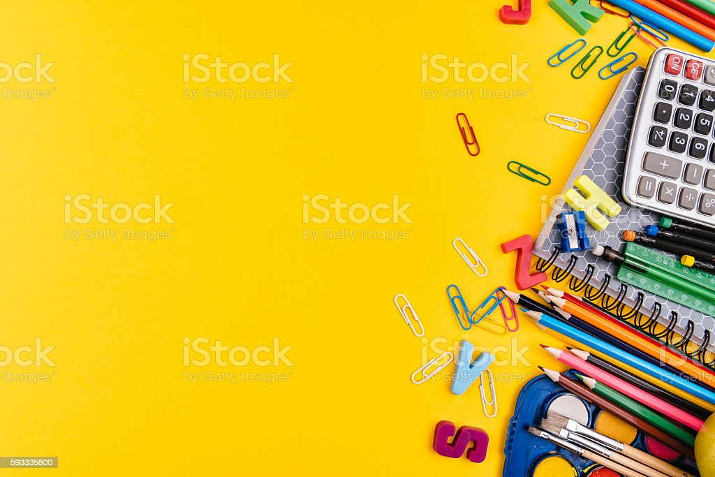 School supplies on yellow background stock photo