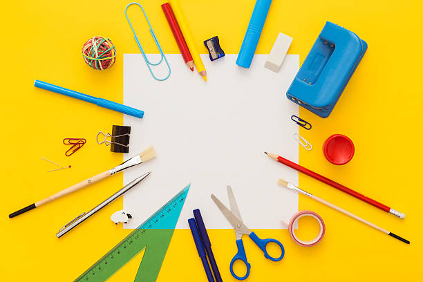 School supplies on yellow desk with copy space.Top view. - Photo