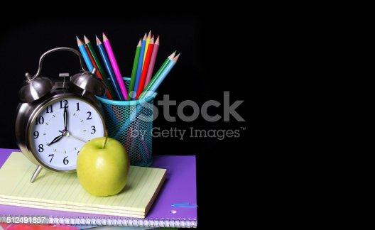 istock School Supplies over black. Studies Accessories 512491857
