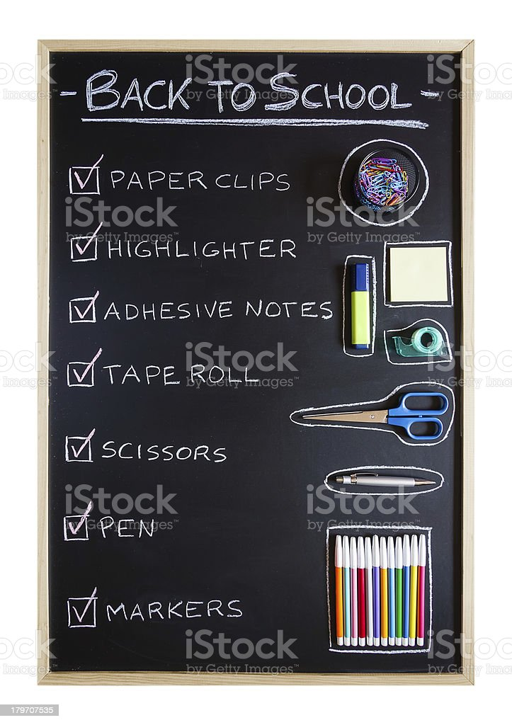 School supplies over blackboard background royalty-free stock photo
