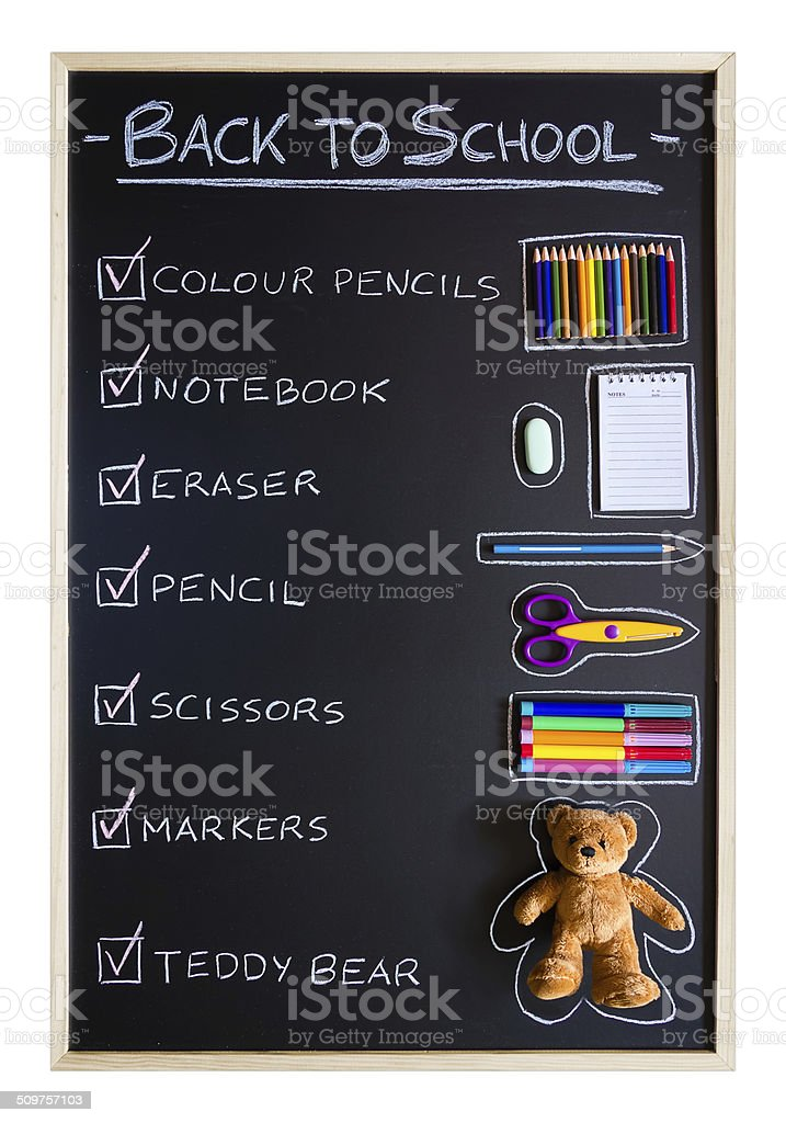 School supplies over blackboard background stock photo