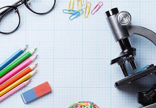 school supplies over paper - 学校の文房具 ストックフォトと画像