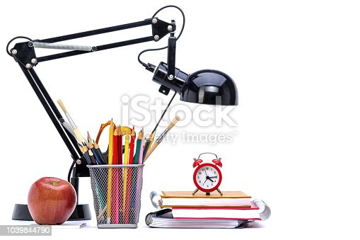 Close up of school and office supplies on white background.