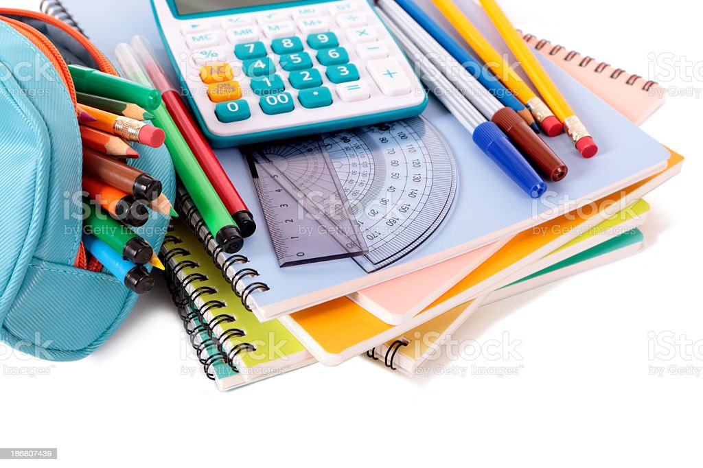 School supplies stacked on white background stock photo