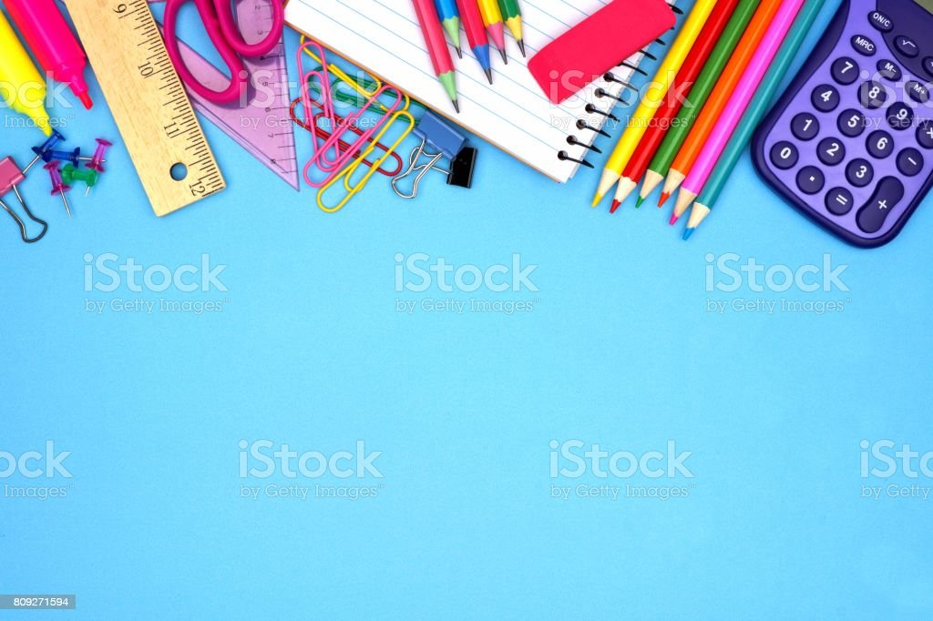 School supplies top border against blue stock photo