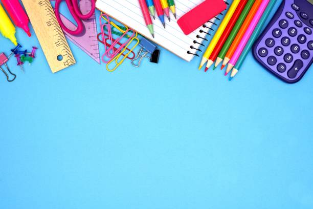 School supplies top border against blue School supplies top border against a blue paper background school supplies border stock pictures, royalty-free photos & images
