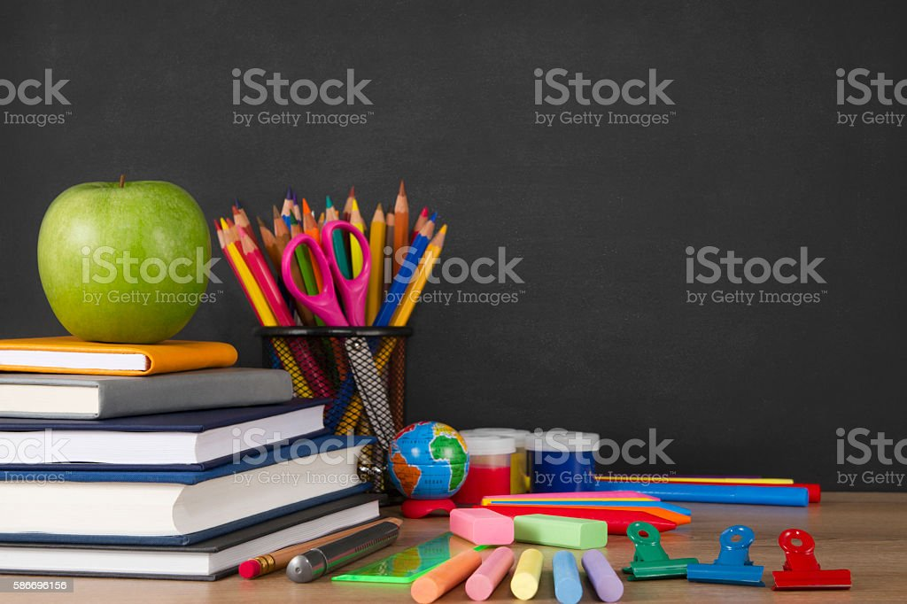 School Supplies with Apple and Chalkboard royalty-free stock photo