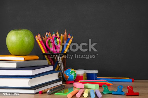 istock School Supplies with Apple and Chalkboard 586696156