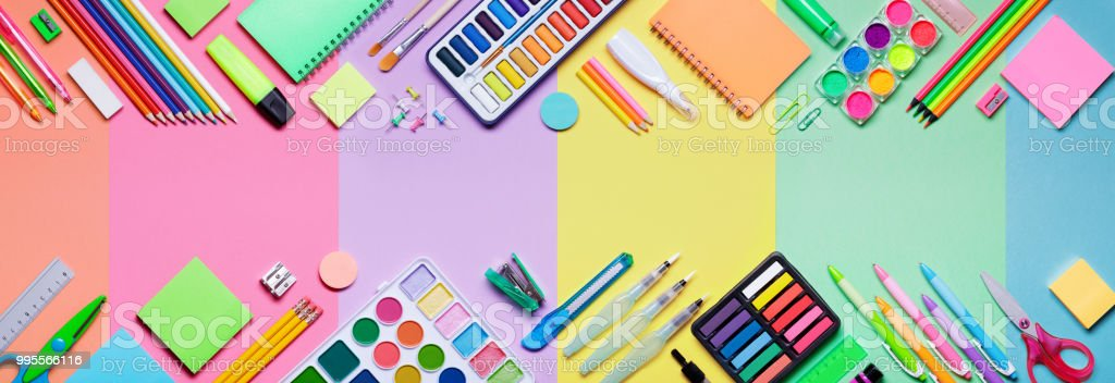 School Supplies With Colorful Paper Background - Banner stock photo
