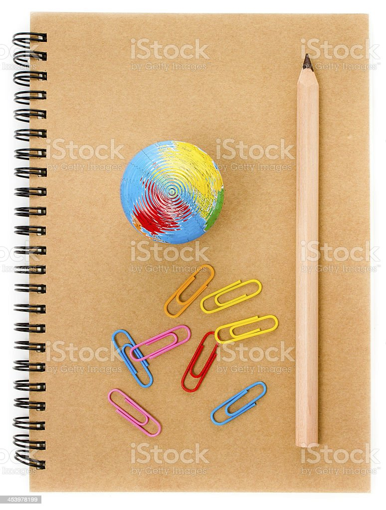 School supplies with Globe, clip and notebook  on white royalty-free stock photo