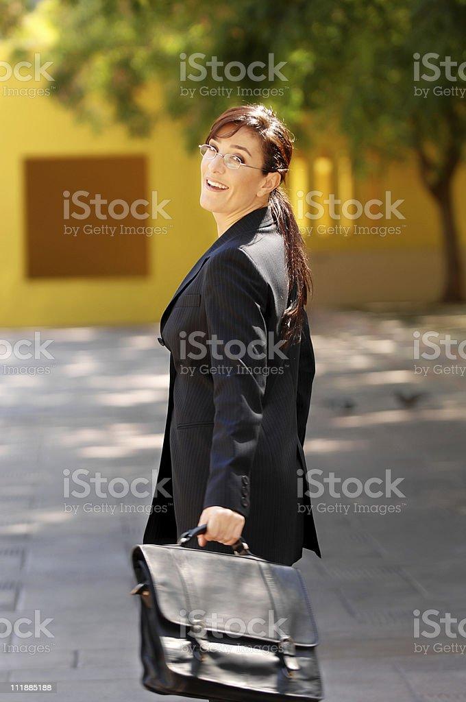 School teacher walking across schoolyard royalty-free stock photo