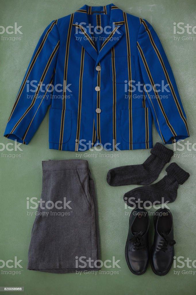 School uniform arranged on chalkboard stock photo
