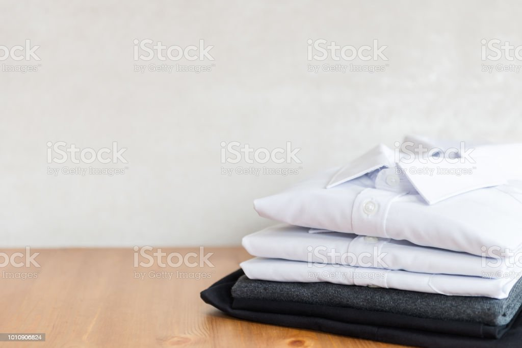 School uniform such as white shirts, sweater and trousers royalty-free stock photo