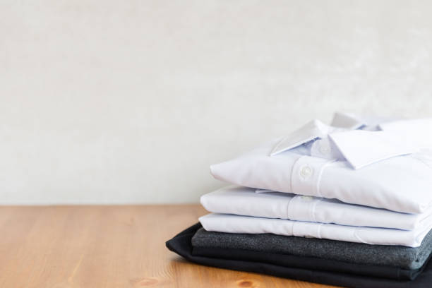 School uniform such as white shirts, sweater and trousers stock photo