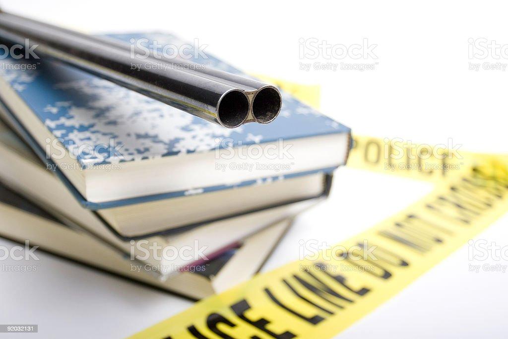 School Violence shotgun on top of schoolbooks stock photo