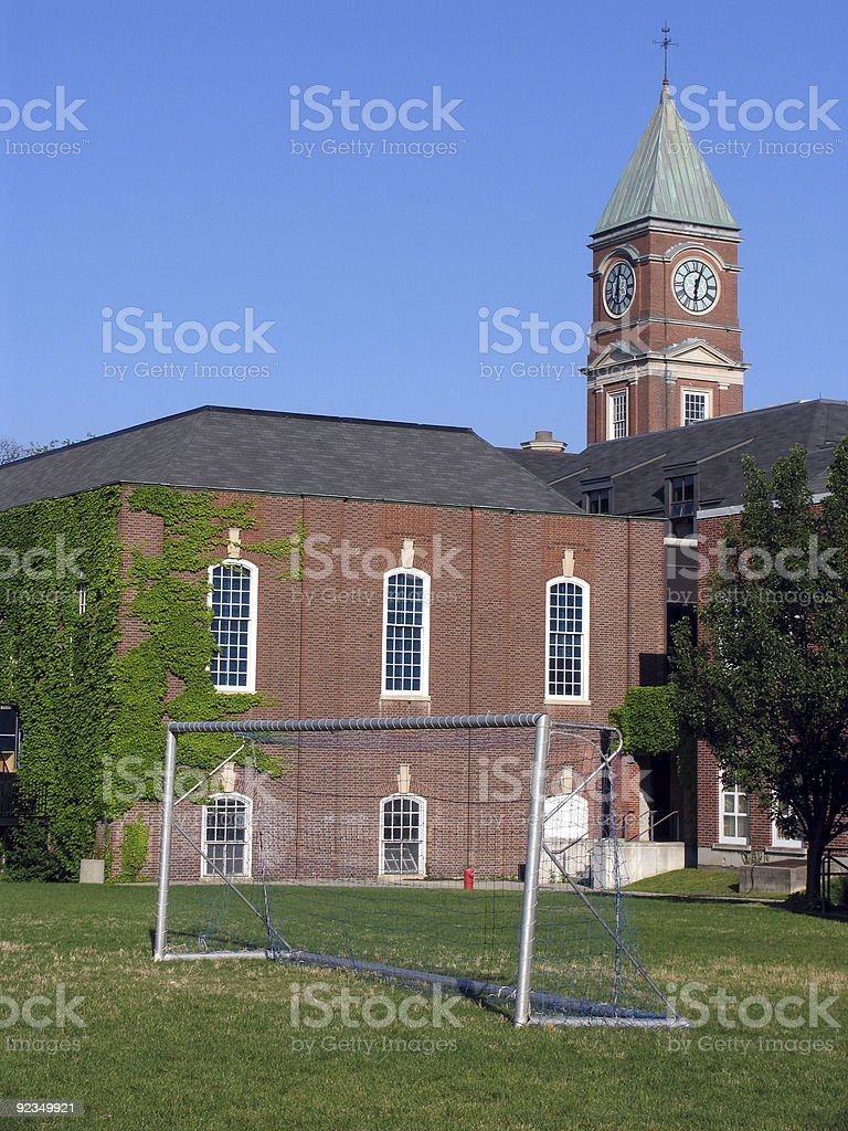School with clocktower and soccer net royalty-free stock photo